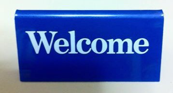 desk welcome sign